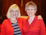 Ladies in red. Anne Alexander (left) and Cathy Baker Schafer (right) taken 5/1/08. A reunion before the reunion.